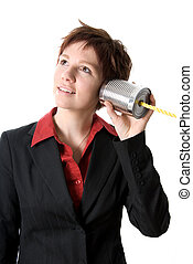 Tin can phone - woman in a suit listening to a tin can phone