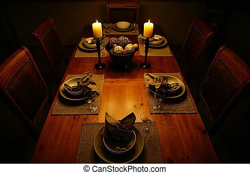 Candlelight dinner - A dinning room table set for a...
