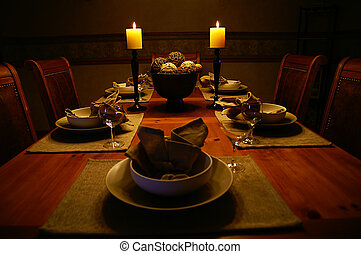 Dinning Room - A dinning room table lit with candles and set...