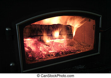 Wood Stove - Wood stove with a blazing fire burning inside
