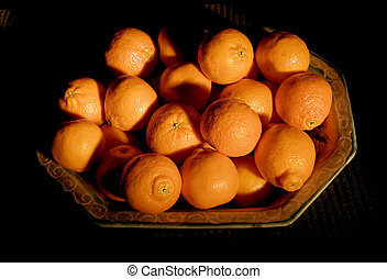 A Pile of Tasty Tangerines on a Mexican Platter - Photo of a...