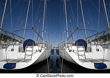 sailing boat - boats anchored in a harbour on a sunny day