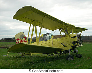 Biplane - Small old field biplane used to pesticide apple...