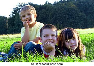 happy children - Happy children in green grass