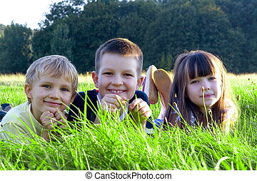 children on a meadow - Happy children in green grass