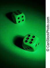 to play dice - To play dice on a green table
