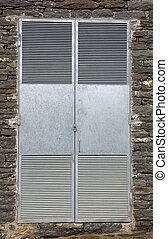 Metal door - Padlocked metal door; utility enclosure in the...