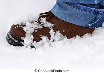 boot with snow,winter day - focus point on the center of the...