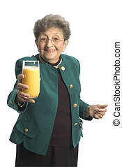 woman with juice - attractive senior woman with glass of...