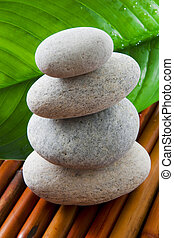Balance - Macro of four staked stones . Zen, spa concept.
