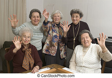 senior women at the game table - group of happy senior women...