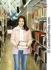 Student - A student carrying books in a library