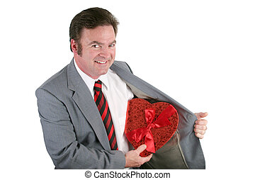 Valentine Revealed - A man in a business suit revealing a...
