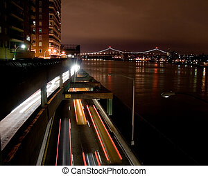 Urban Traffic at Night on FDR Drive in New York City