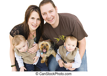 Young family with twin boys and a dog looking up