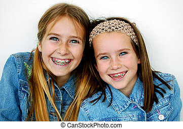 Sisters - Two happy sisters, one eleven years old, the other...