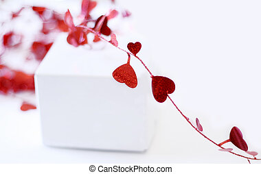 Hearts - Red hearts and blank white box out of focus; space...
