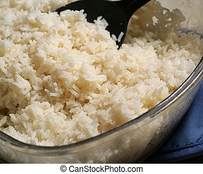 Cooked Rice - Bowl of steaming white rice with spoon