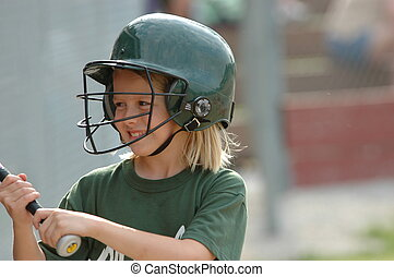 Distracted On Deck - Young girl softball player distracted...