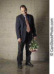 sad man - a sad man with a bouquet of roses