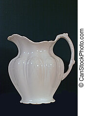 Milk Pitcher - A white glass pitcher isolated against a...