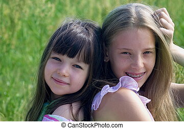 Beauti girls siting on grass