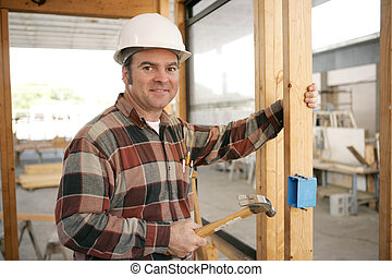 Electrician Installing Box - An electrician on a...