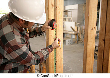 Electrician Measuring - A construction electrician measuring...