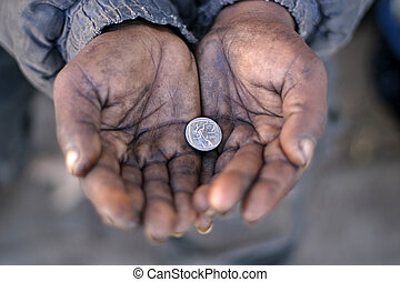 Gipsy - A Gipsys hands holding a silver coin