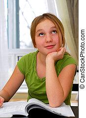 School girl - Young school girl doing homework at her desk