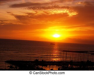 Waikiki Sunset - Dramatic orange sunset at Waikiki Beach