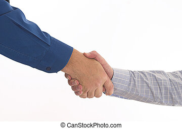 Handshake - Two businessmen in blue shirts shake hands over...
