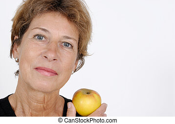 Health - Older woman with an apple