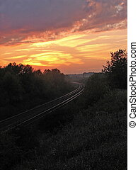 Tracks at Sunset #2 - Railroad tracks leading off into the...