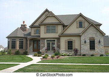 Brick house - Midwestern home featuring brick and stone...