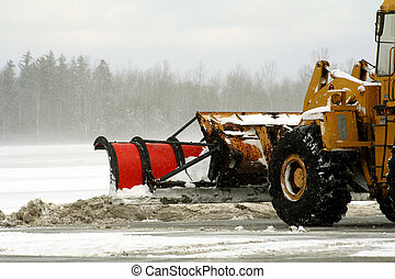 Snow Removal - Snow plow removing snow at airport after...