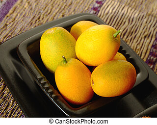 kumquats - Close-up of fresh kumquats