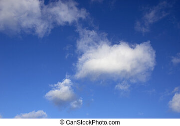 Sky Background - A blue sky with some white clouds.