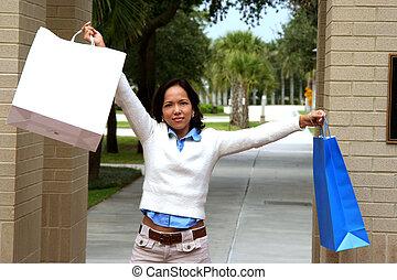 Happy Shopper - Happy female shopper holding bags