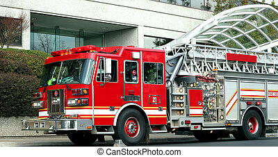 Fire Truck - A red fire truck at the scene of an emergency