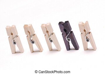 Odd man out - clothes pegs with one black one - concept of...