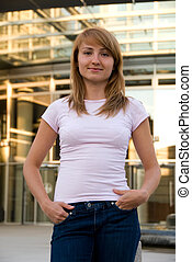 active girl - Young woman standing in front of business...