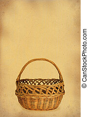 wicker basket against stained retro paper