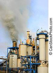 Industrial pollution - Smoke rising from industrial sugar...
