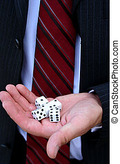 Business Risk - Closeup of dice in hand of man wearing suit