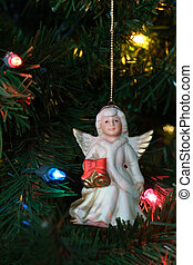 ANGEL ON TREE - Ceramic angel ornament on Christmas tree