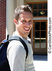Happy Student - Male student with backpack smiling at camera