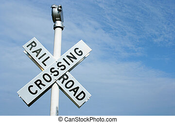 Railroad Crossing Si - Railroad crossing sign against blue...