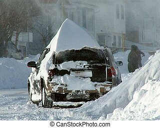 buried in snow - a vehicle buried in snow after a winter...