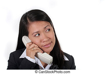On the Phone - Asian Businesswoman on the phone looking at...